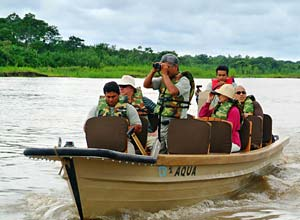 Travelling by skiff in the Amazon